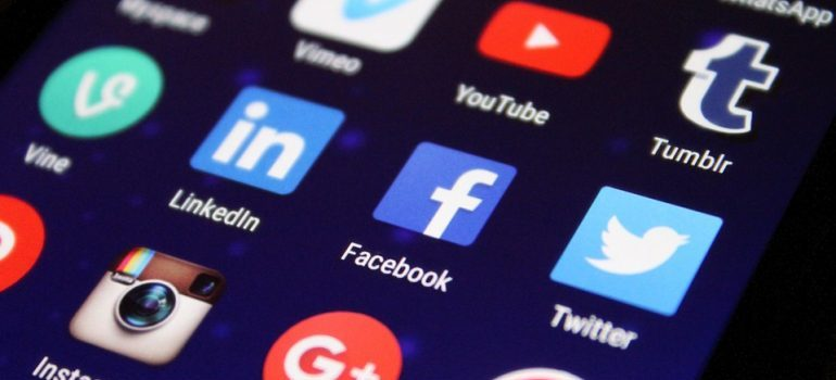 Social media app icons on a smartphone screen.