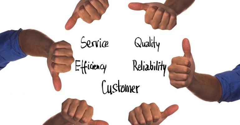 """Team members giving the """"thumbs up"""" for different aspects of quality service."""