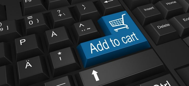 """""""Add to cart"""" blue button on a black keyboard."""