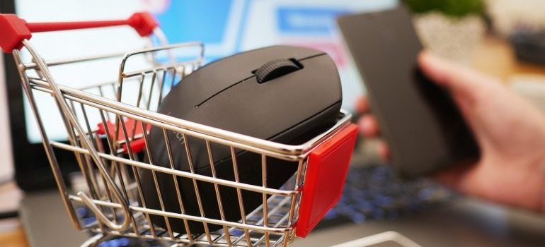 Calling customer support to return a computer mouse in a miniature shopping cart just after the purchase.