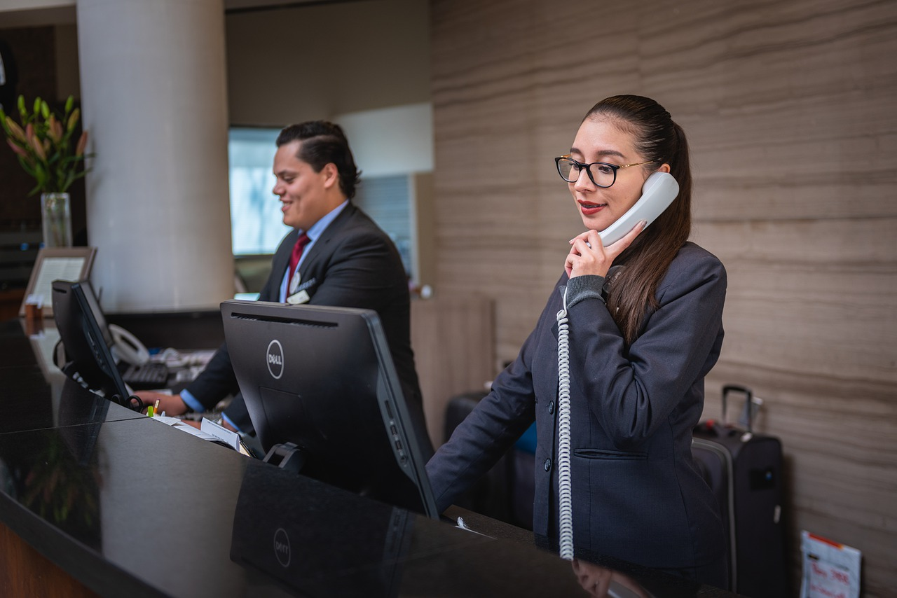 Smiling sales agents convincing the client to buy over the phone.