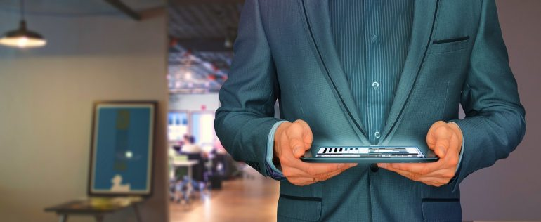 A businessman checking the inbound sales reports on his tablet.