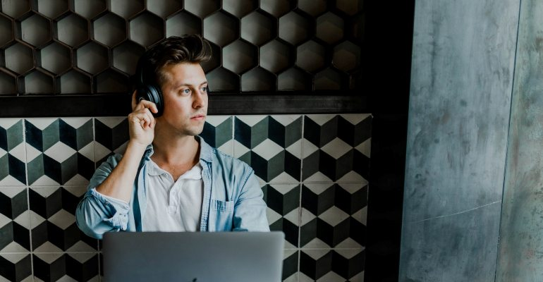 A man thinking about how to keep your online calls encrypted and secure.
