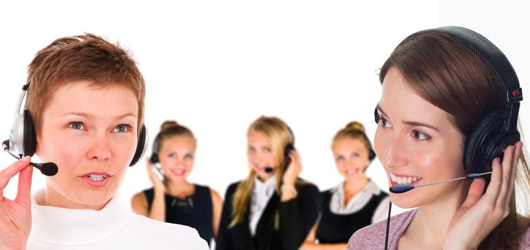 A polite call service representative talking with potential customers.