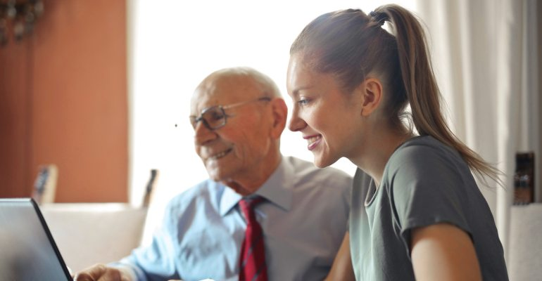 An old man and a young woman talking about improving lead generation through phone calls.